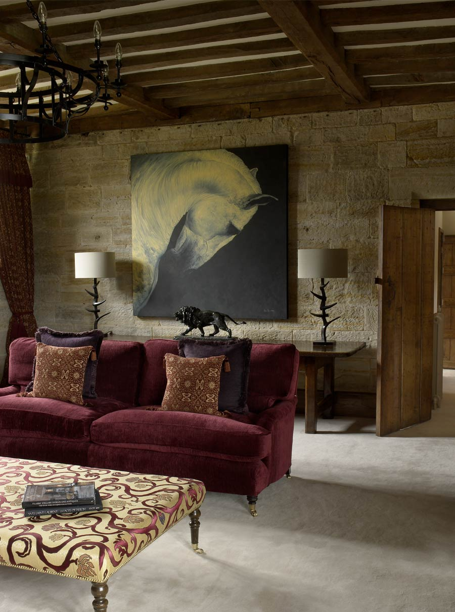 Plum Velvet Sofa In Country House Living Room With Statement Table Lamps  And Artwork Against Original